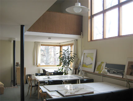 the living area of the house is open plan with a wall of windows looking out down the slope of the garden curtains separate the sitting room from the - Alvar Aalto House Plans